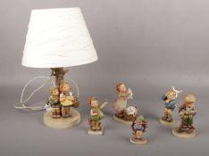 Five Goebel ceramic figures, Boy with Toothache Hum 217, Little Tailor Hum 308, Wash Day Hum 321