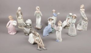 A collection of mainly NAO figures, Panda eating Bamboo, ballerina stretching, girl holding a tray