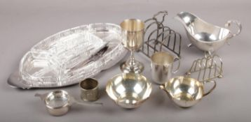 A collection of silver plate, to include hors d'oeuvres set, Prima sugar bowl and cream jug, toast