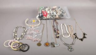 A large collection of costume jewellery to include, a selection of plastic and metal necklaces and