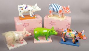 Five boxed ceramic Party Pigs to include Piggy En Pointe , Day at the Beach, Bottoms up, etc.