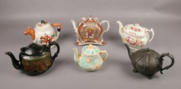 A selection of six teapots, to include a Burgess & Lee teapot and stand from the Aesthetic
