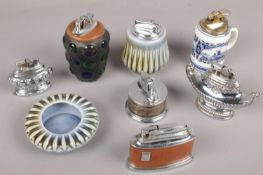 A collection of table lighters to include Delft, Colibri, multi coloured glass example, etc.