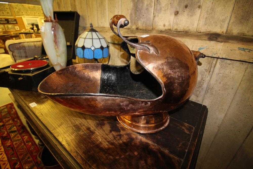Lot 233 - Copper hand beaten coal helmet