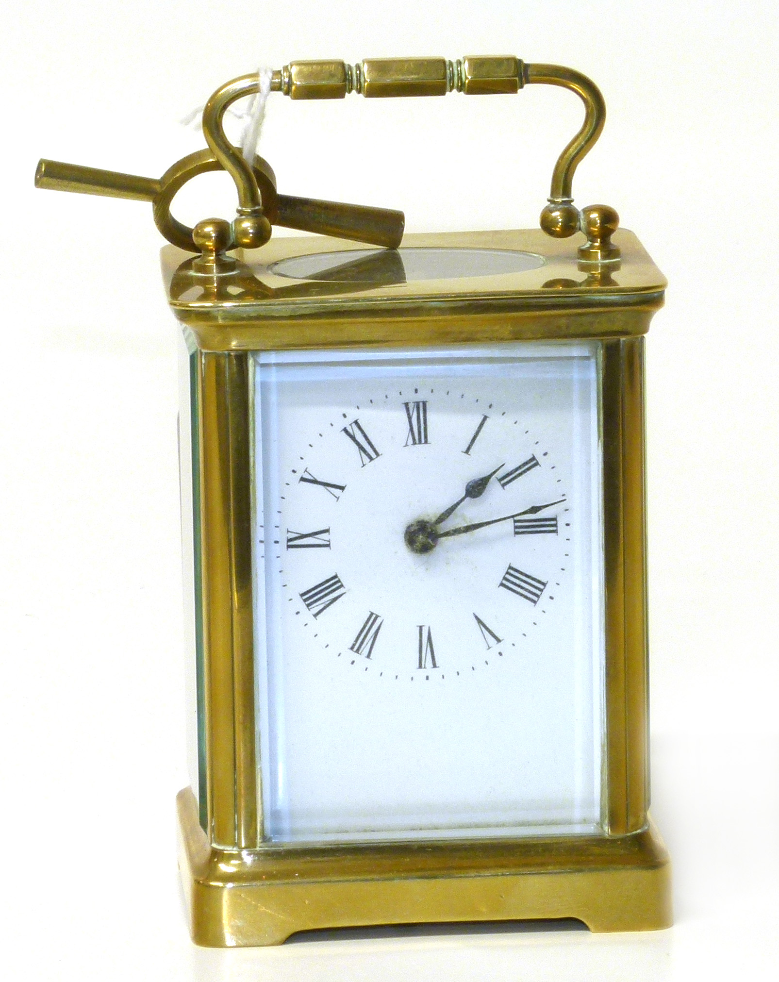 Lot 82 - Early 20th century brass carriage clock with enamel face and Roman numerals complete with winder