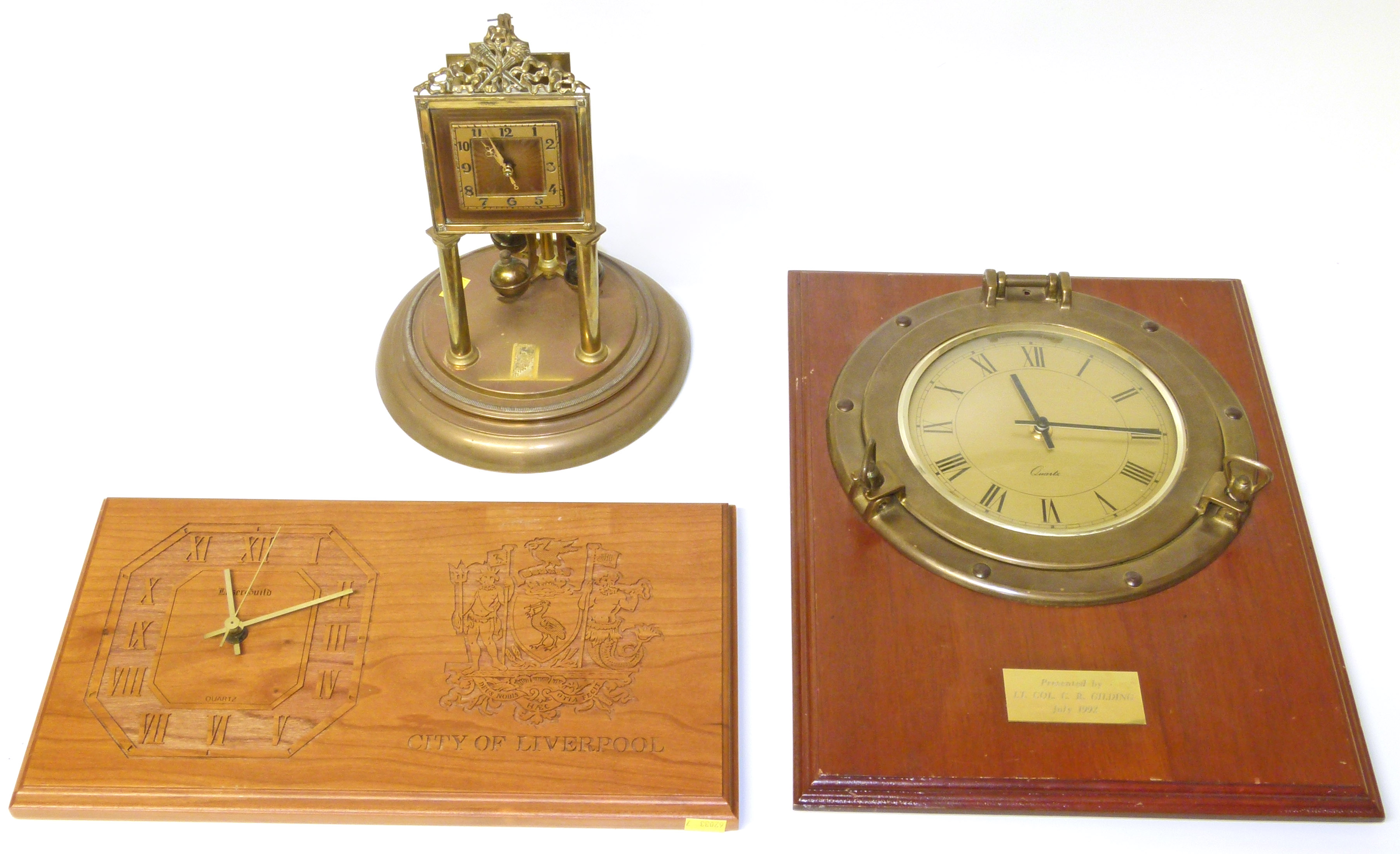 Lot 83 - Ships Porthole clock, City of Liverpool clock, and one other brass clock We are unable to do
