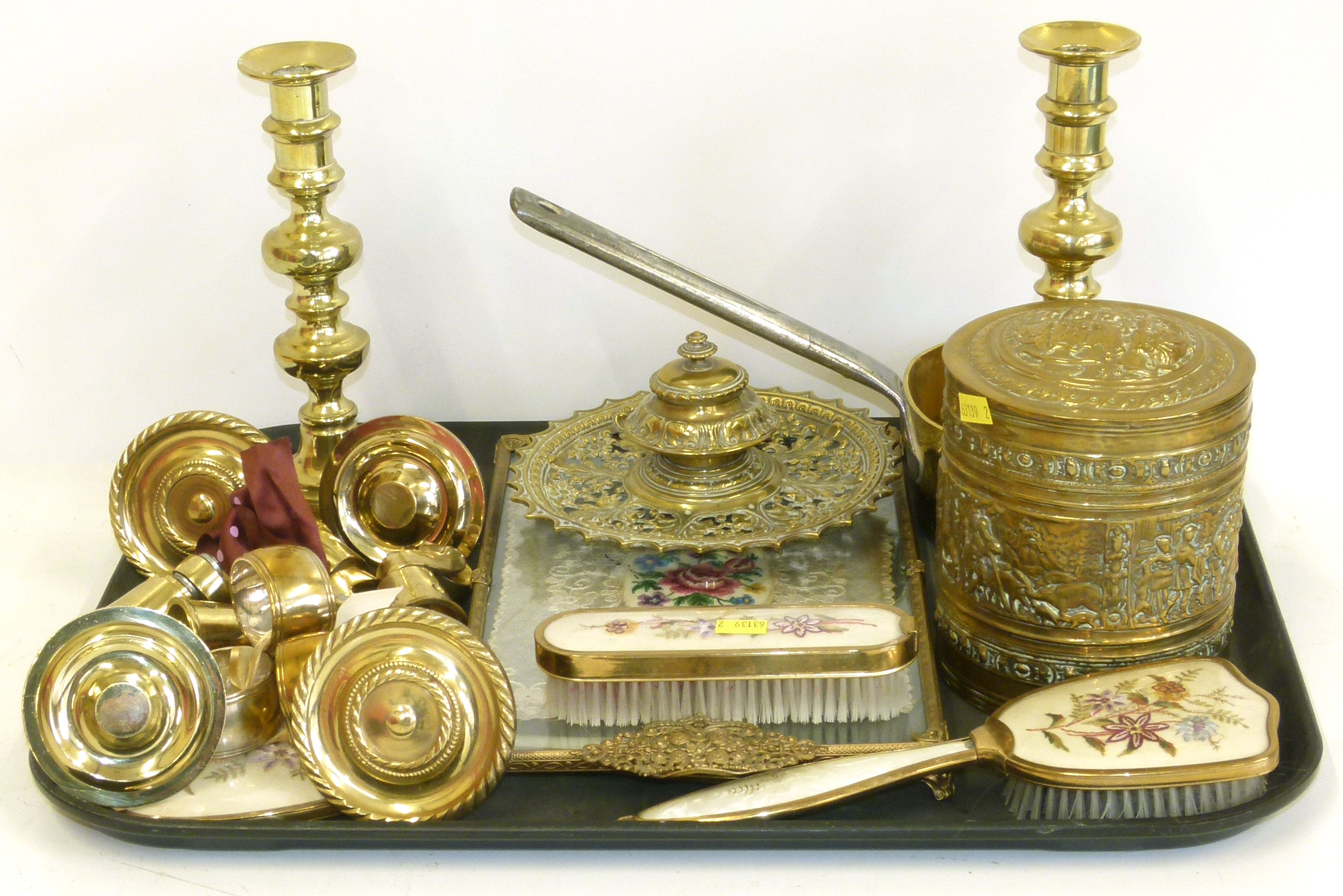 Lot 68 - A collection of brass to include a pair of candlesticks, saucepan, pierced inkwell, 4 castors,