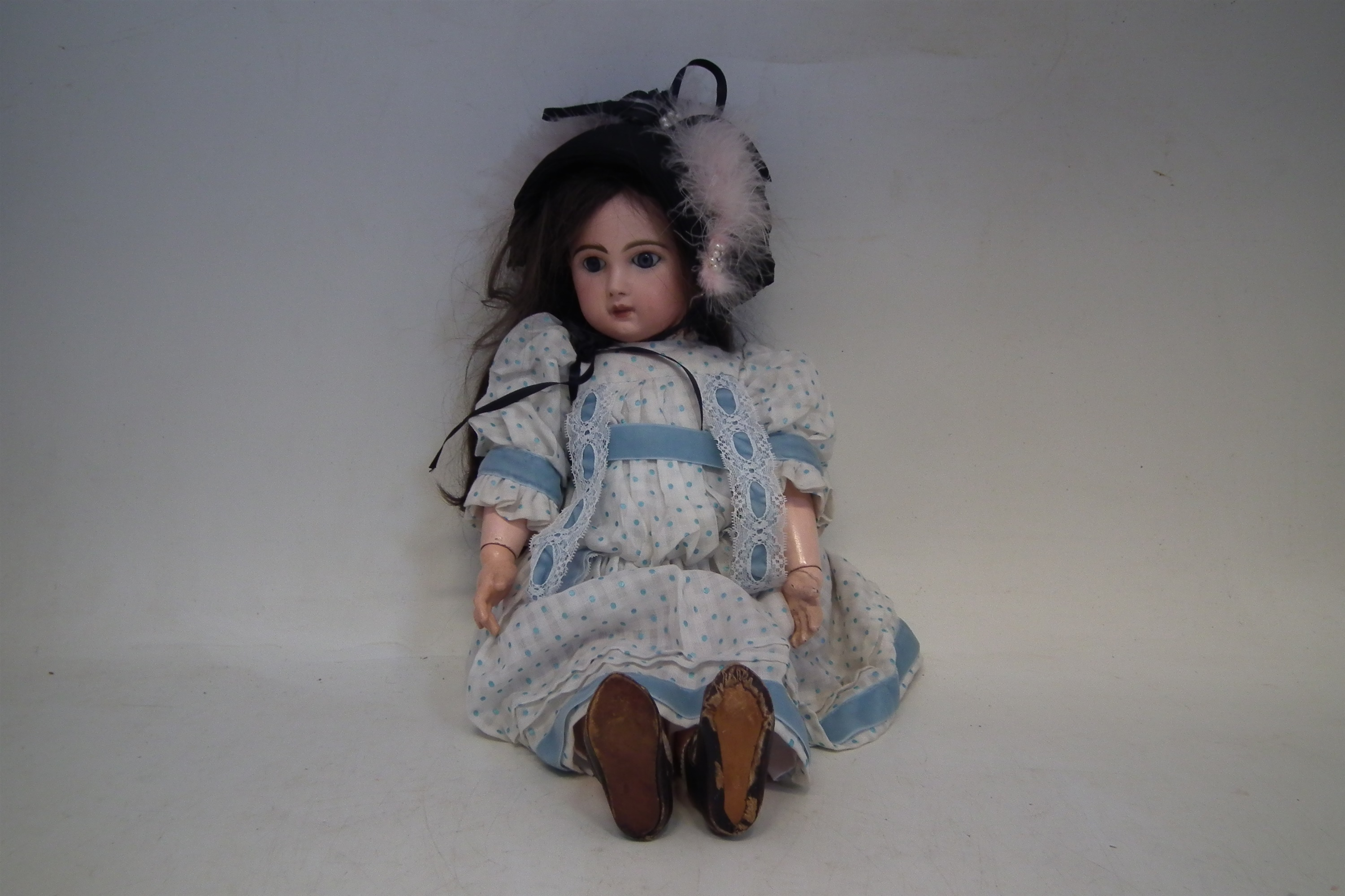 Lot 107 - Jumeau doll, with closed mouth and open eyes, the reverse of head marked with transfer B.G.D.G,