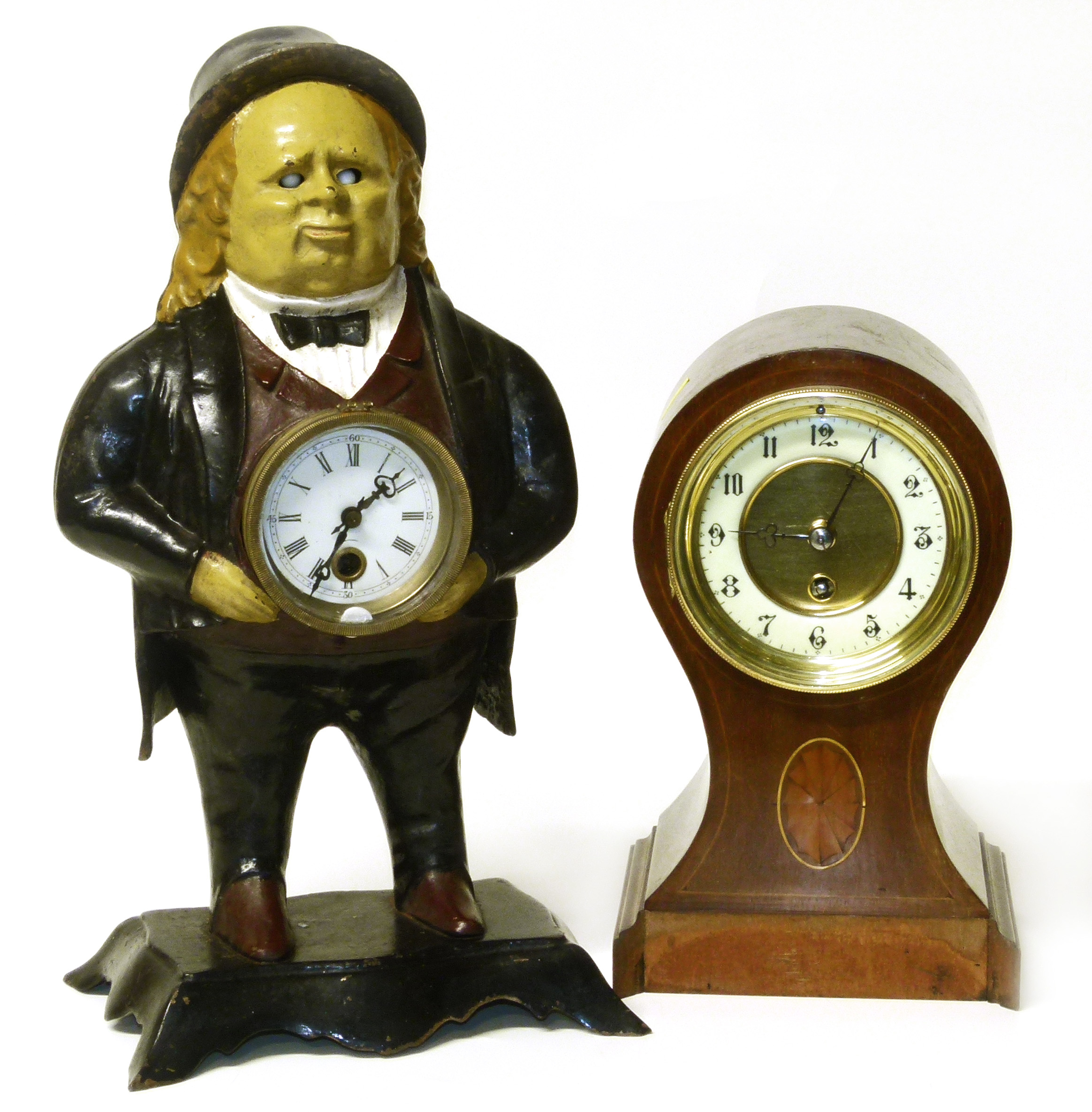 Lot 77 - Cast iron clock and a balloon clock We are unable to do condition reports on our Interiors Sale