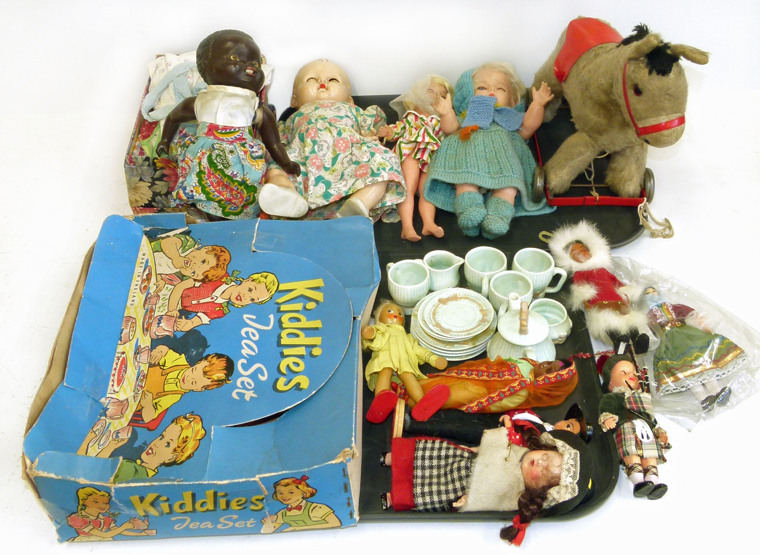 Lot 96 - 15 piece dolls house set complete with box, Rosebud, Pedigree and two other dolls, 7 smaller dolls