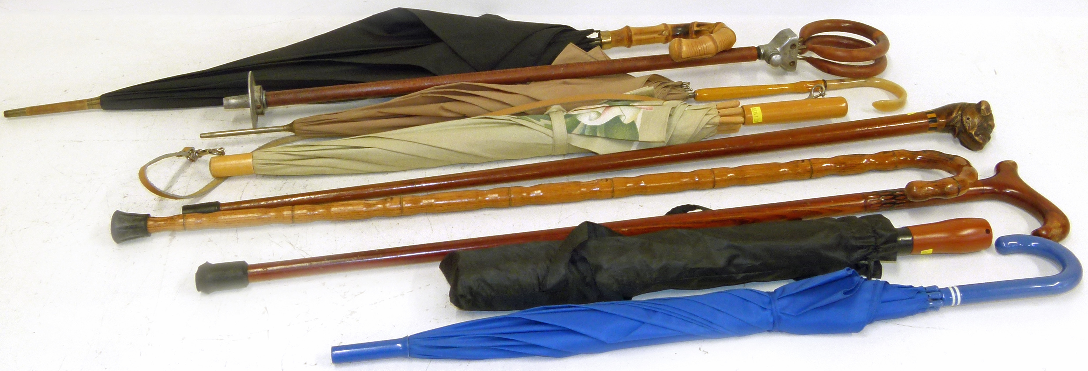 Lot 60 - Middlemores Seatanstic shooting stick, walking stick with hand carved English Boxer top and 7