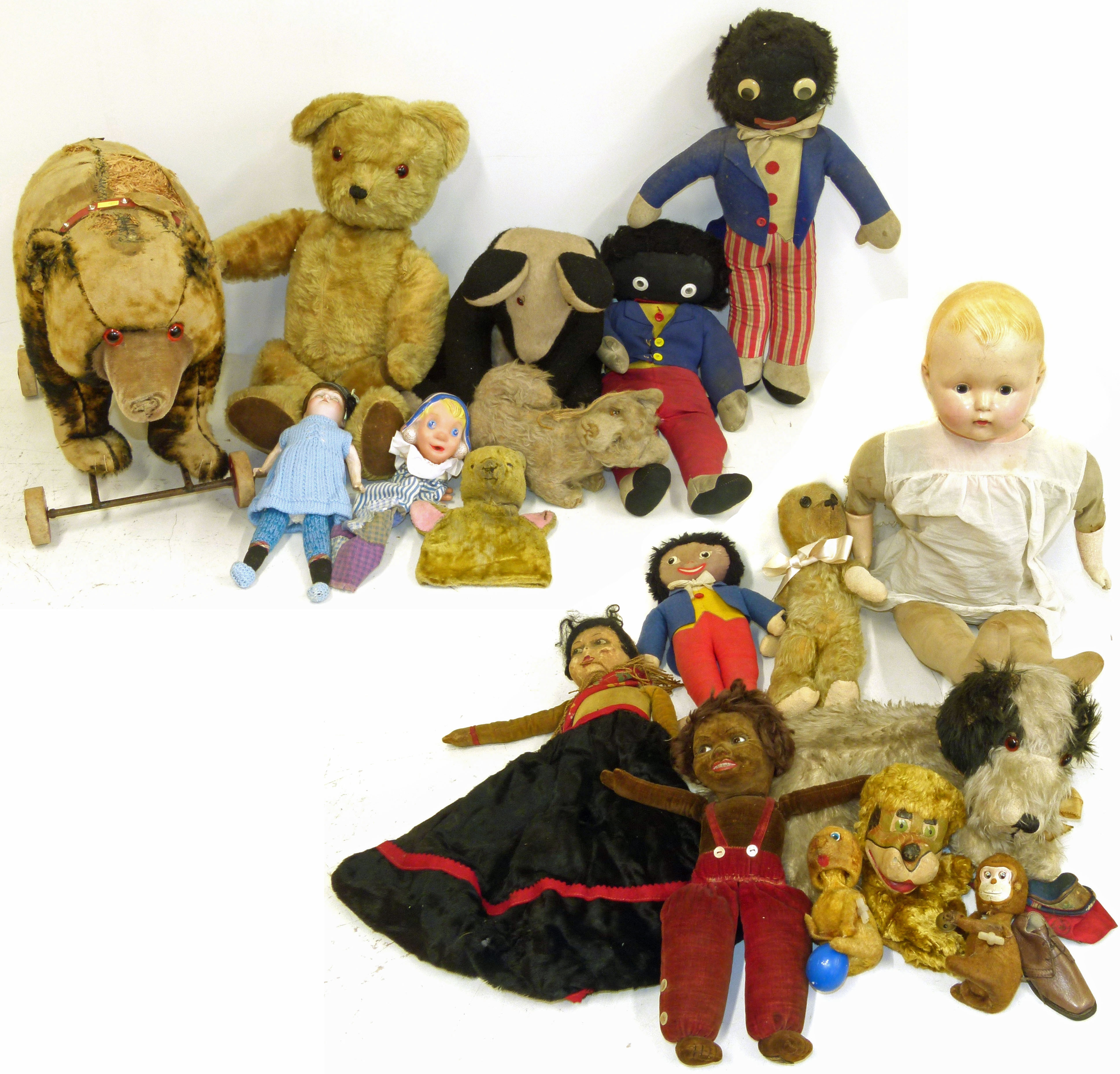 Lot 102 - Collection of dolls, vintage soft toys and a push along bear We are unable to do condition reports