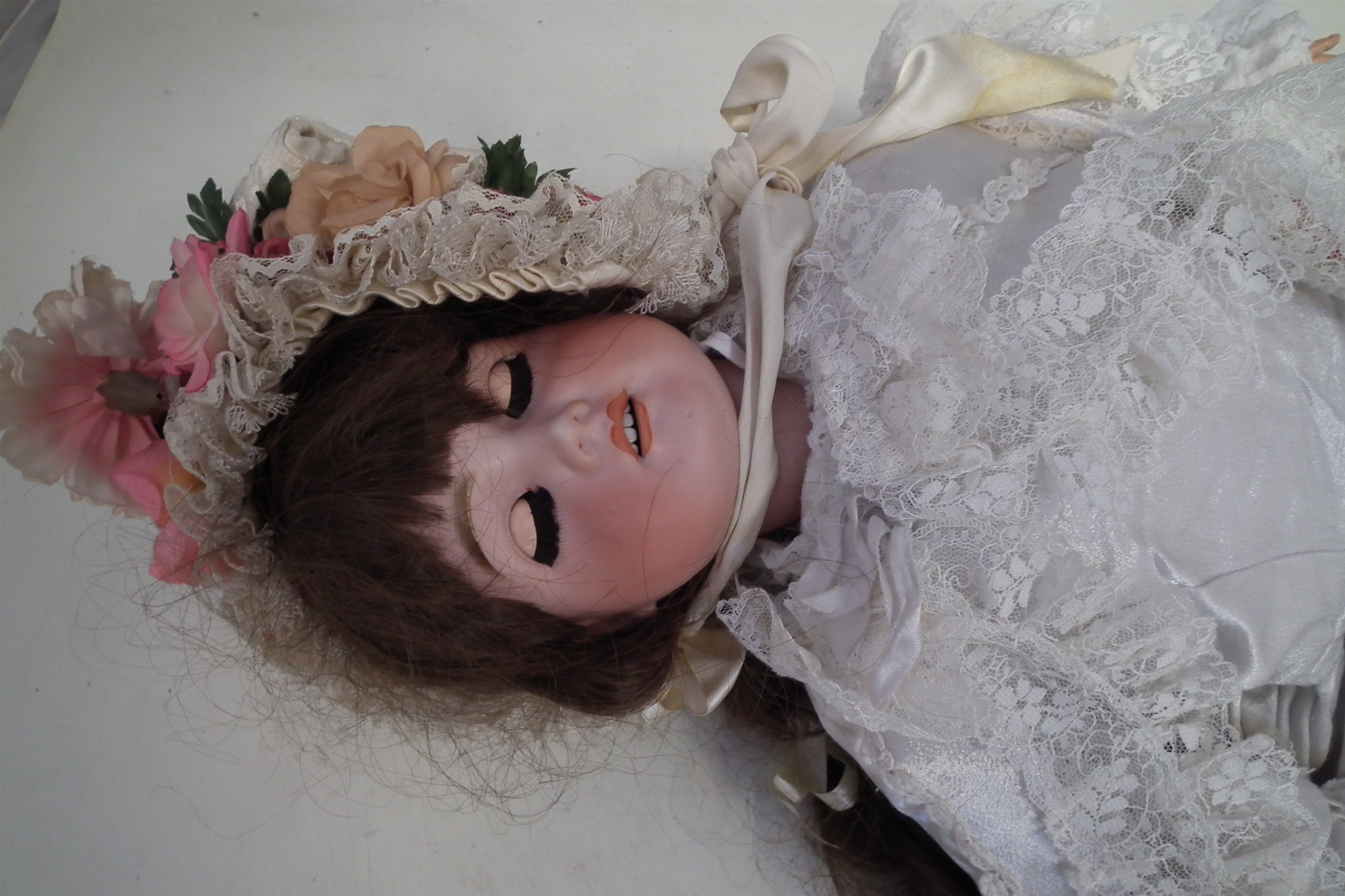 Lot 109 - Jumeau doll, with open mouth and sleep eyes, marked with an impressed 70 to reverse of head, 70cm