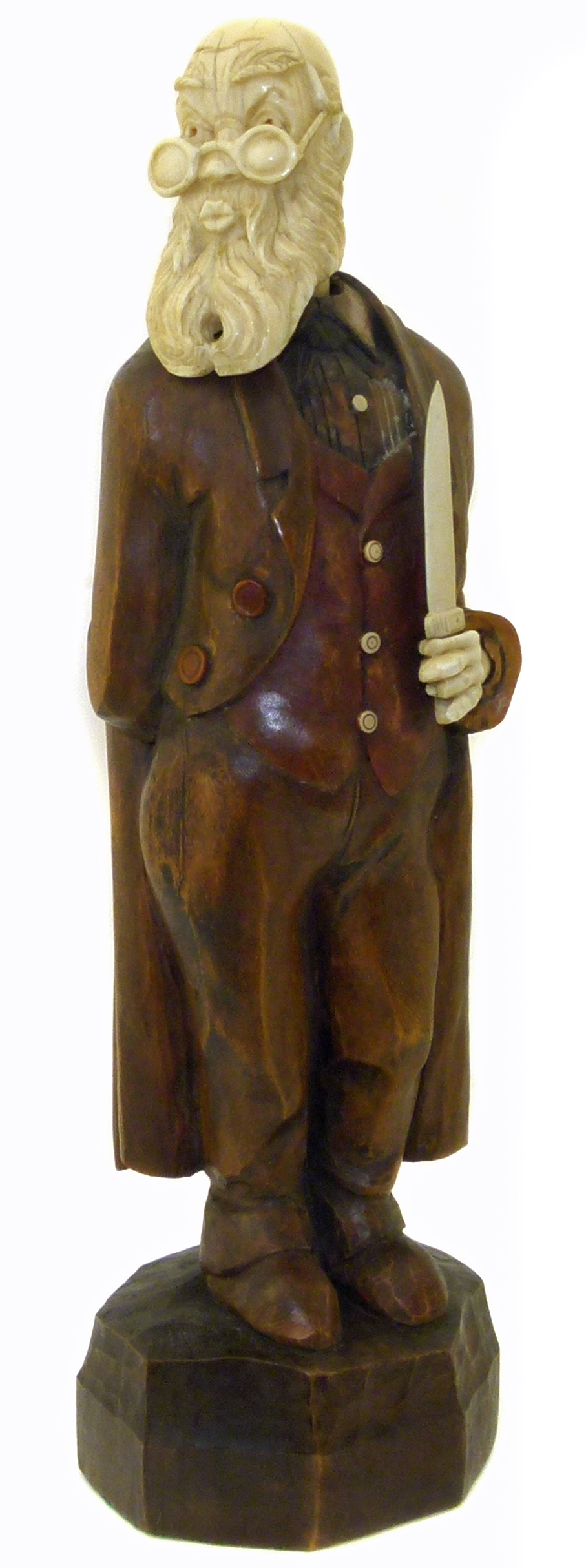 Lot 48 - An early 20th Century German carved wood and ivory automaton, modelled as a whistling gentleman with