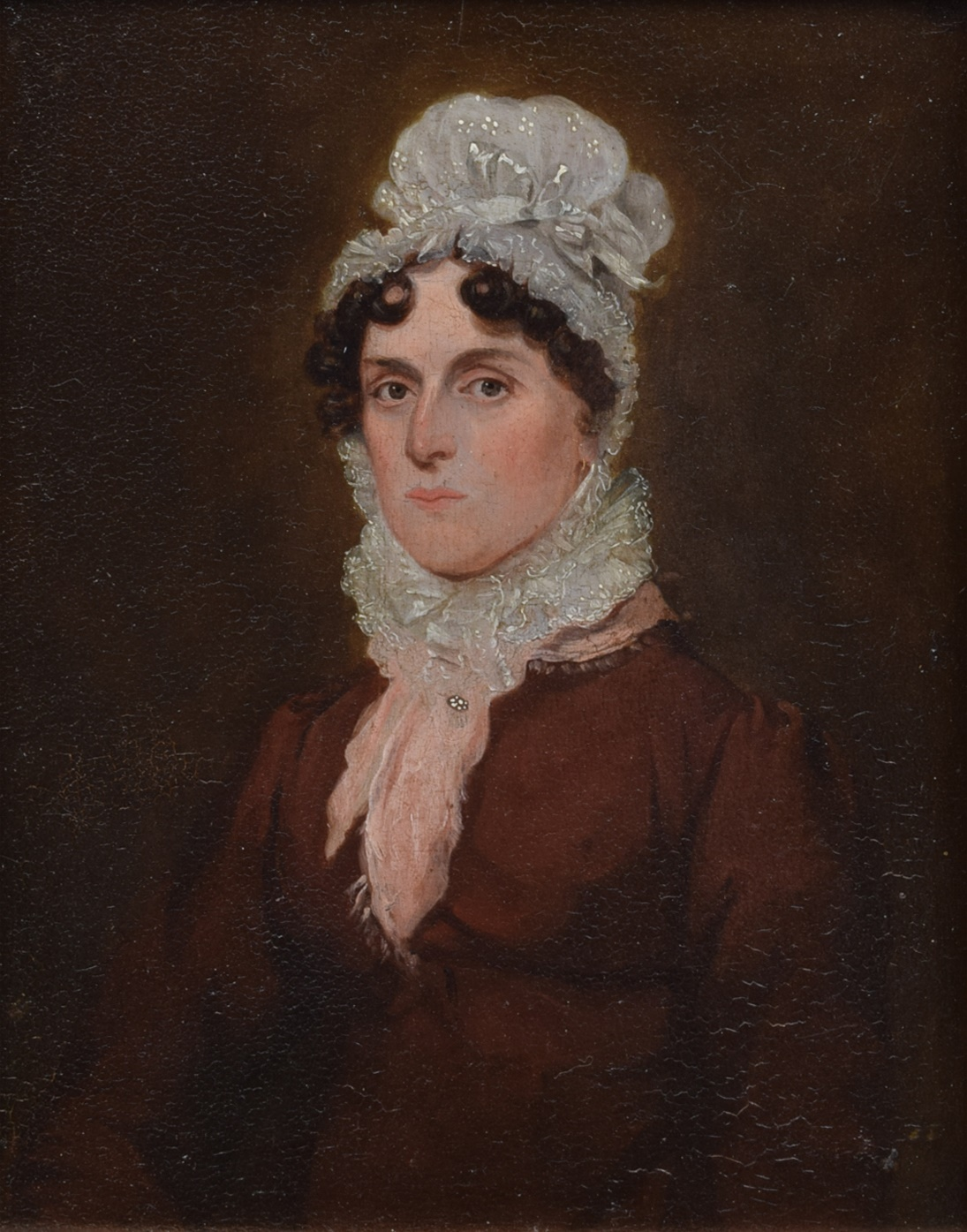 Lot 18 - English School, 19th century, Portrait of a lady wearing a lace cap, unsigned, oil on board, 17.5