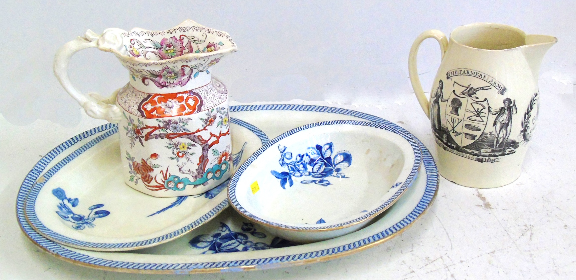 Lot 114 - Creamware jug named M.E, Caurens also an octagonal jug and three graduated Wedgwood meat plates We
