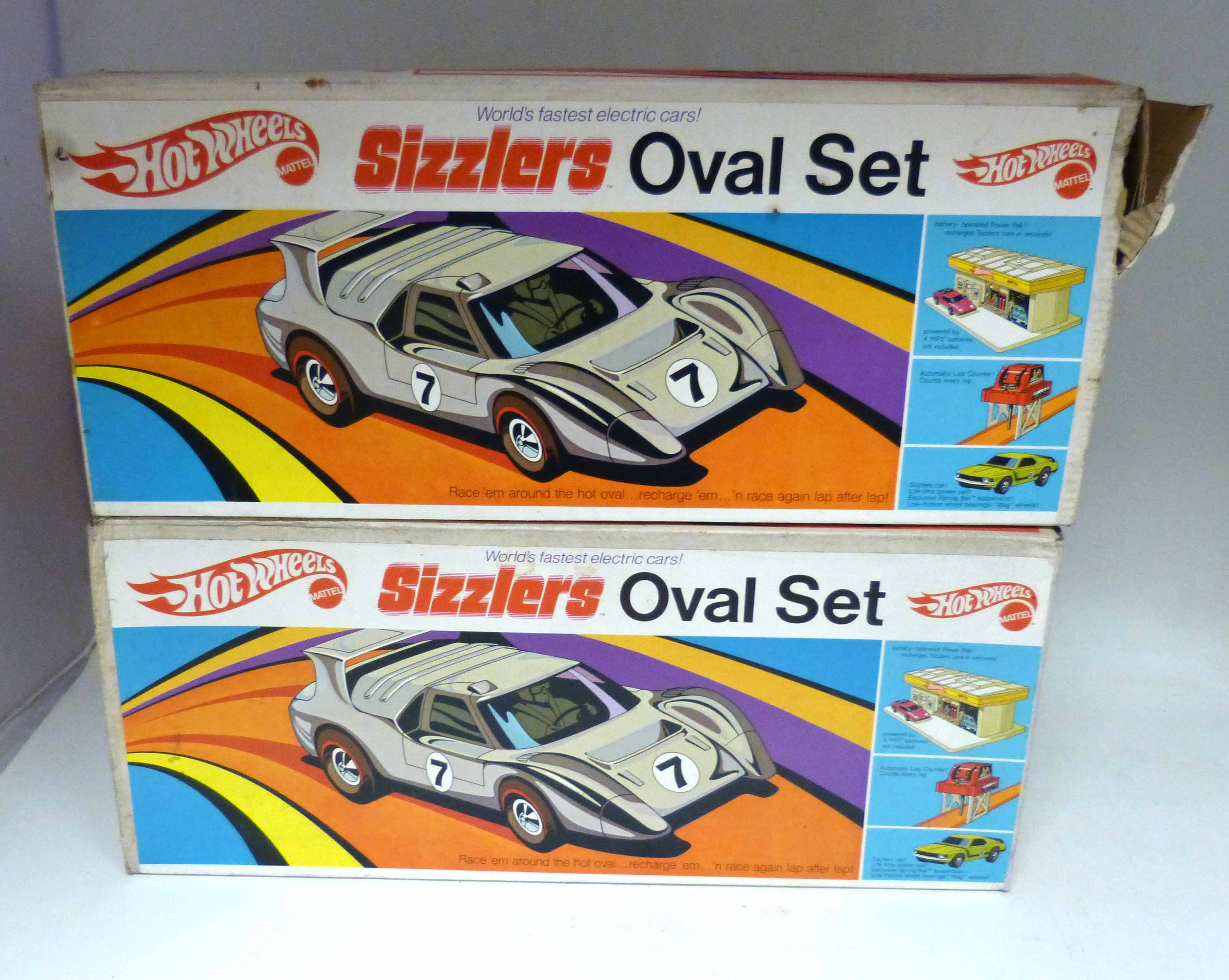 Lot 93 - Two boxed Hot Wheels Sizzlers oval sets We are unable to do condition reports on our Interiors Sale