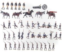 Fifteen metal Prussian infantry soldiers, also twenty British Marines, and an artillery unit.