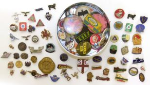A collection of badges and enamel lapel badges