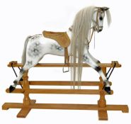 Modern white painted and dappled rocking horse