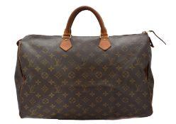 A Louis Vuitton monogram Speedy 40 handbag,