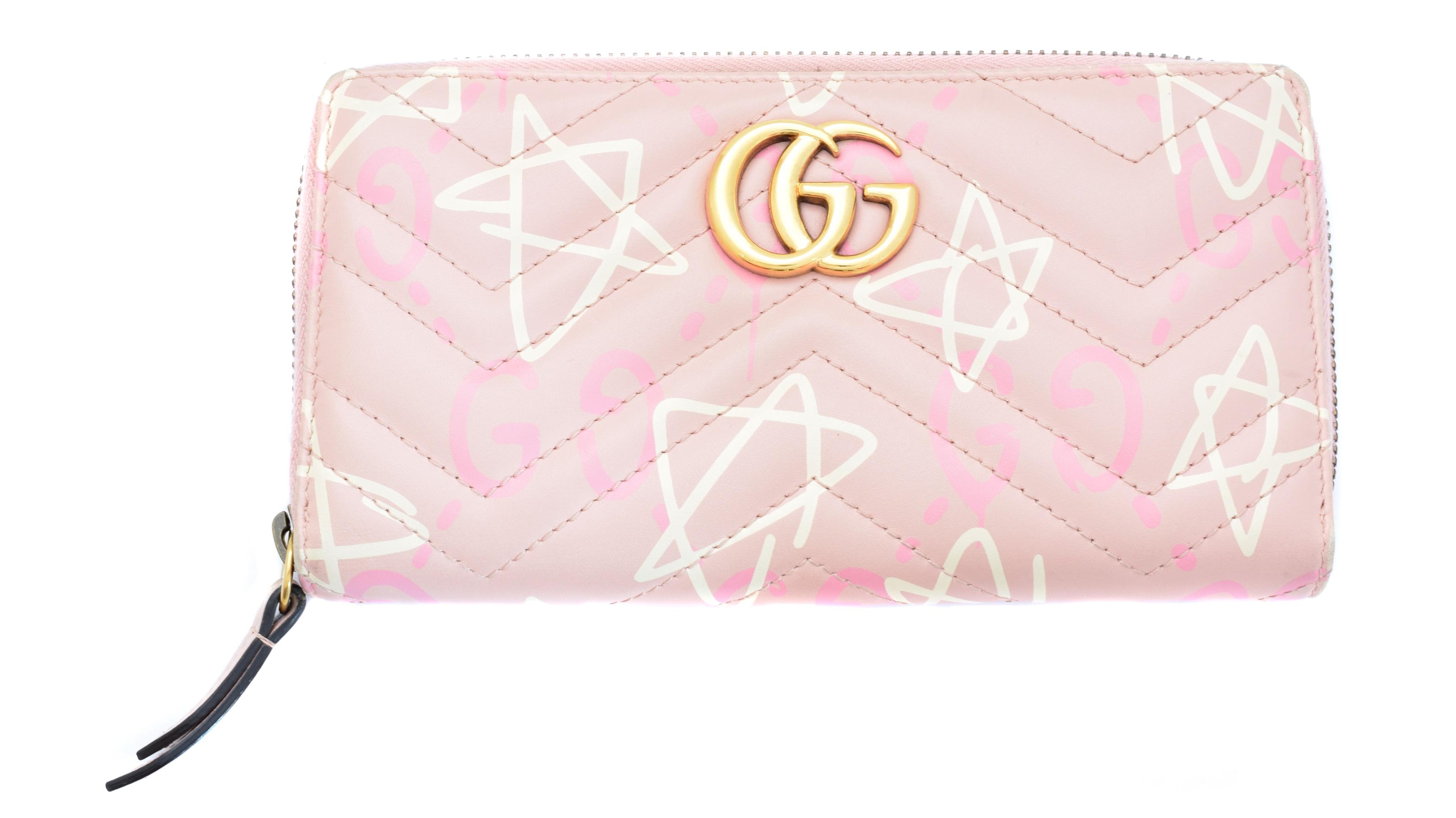A Gucci Marmont zip around wallet,