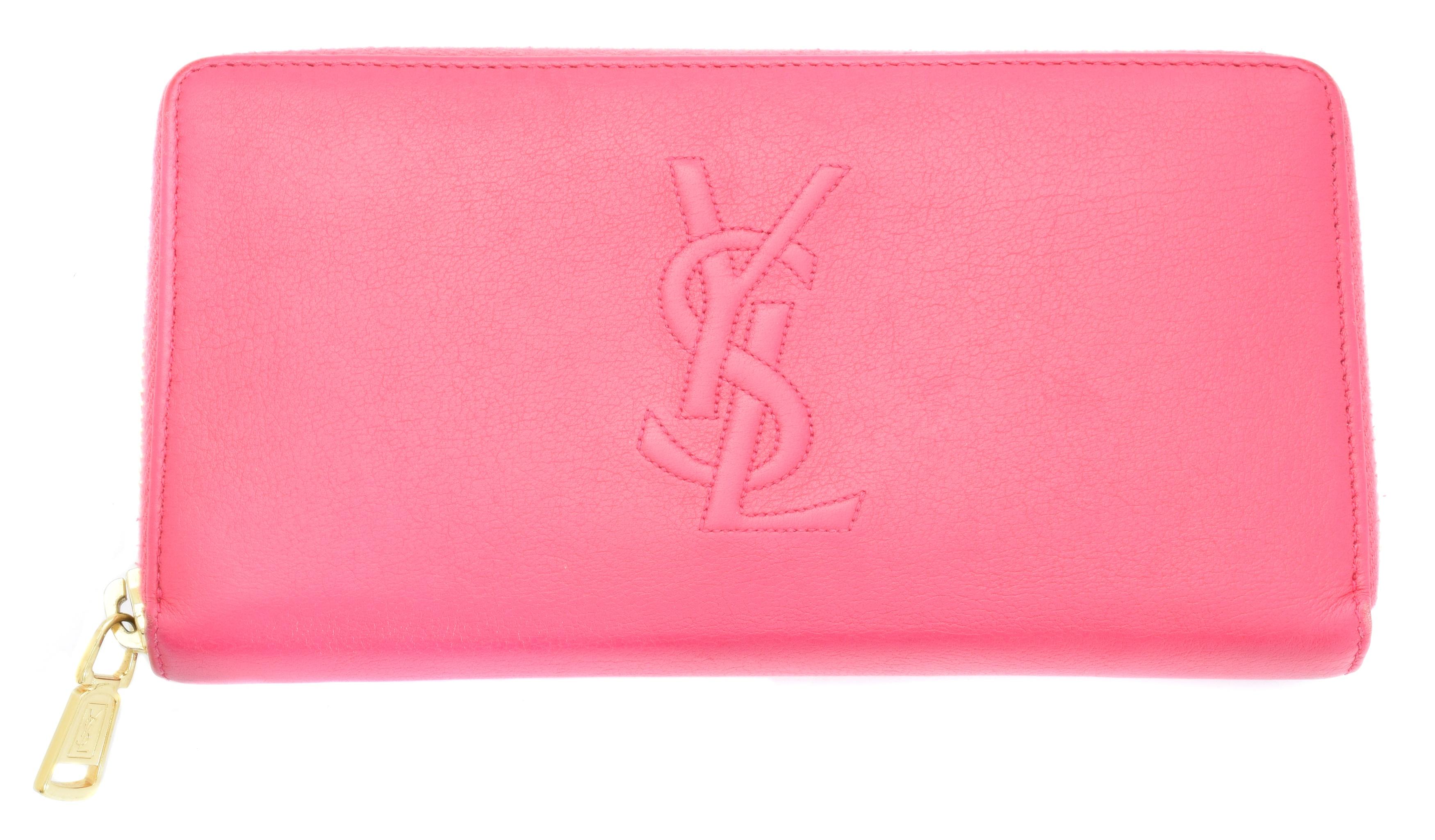 A Yves Saint Laurent zip around logo wallet,