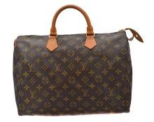 A Louis Vuitton monogram Speedy 35 handbag,