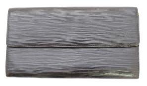 A Louis Vuitton Sarah wallet,