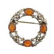 An Arts & Crafts style citrine brooch,