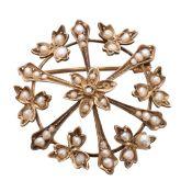 An early 20th century split pearl brooch,