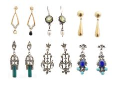 A selection of gold and silver earrings,