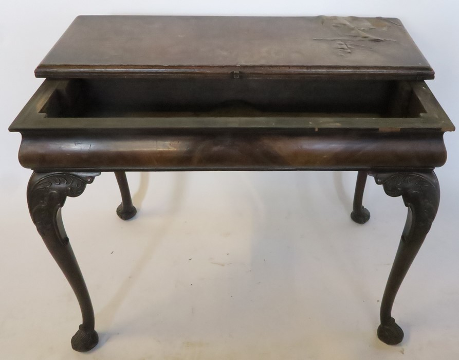 Lot 39 - A 19th century mahogany fold over side table, the rectangular fold over top supported by pull out