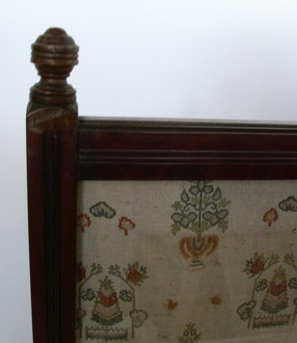 Lot 3 - An Edwardian mahogany fire screen, with glazed rectangular panel, having fluted decoration, height