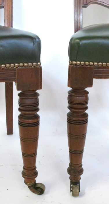 Lot 27 - A set of six oak dining chairs, with carved and upholstered backs, raised on carved front supports
