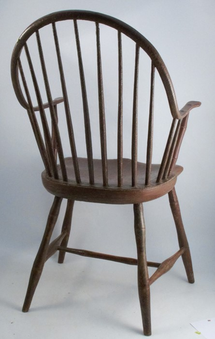 Lot 55 - A primitive antique Windsor armchair, with some simulated bamboo spindles, showing signs of original