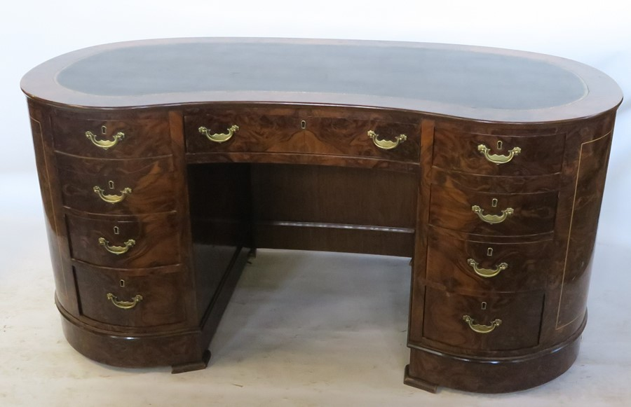 Lot 1 - A walnut veneered kidney shaped kneehole desk, with tooled leather inset writing surface, fitted