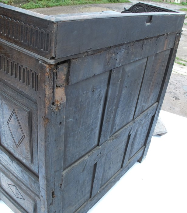 Lot 28 - An Antique oak carved sideboard cupboard, the top with carved gallery to the back and sides, with