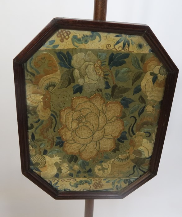 Lot 21 - A 19th century mahogany pole screen, the octagonal screen with embroidered floral panel, on a