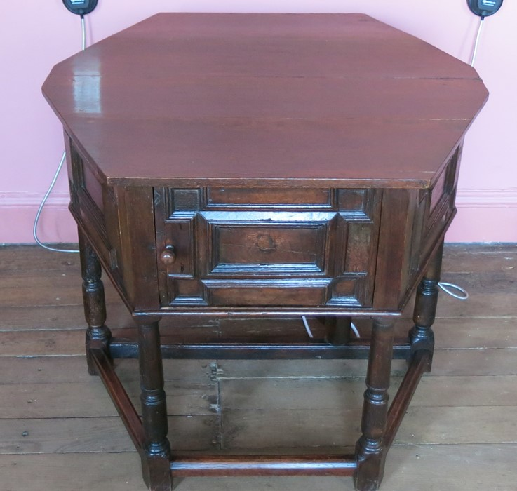 Lot 16 - A 17th century style oak credenze table, the octagonal folding top supported by a gateleg action,