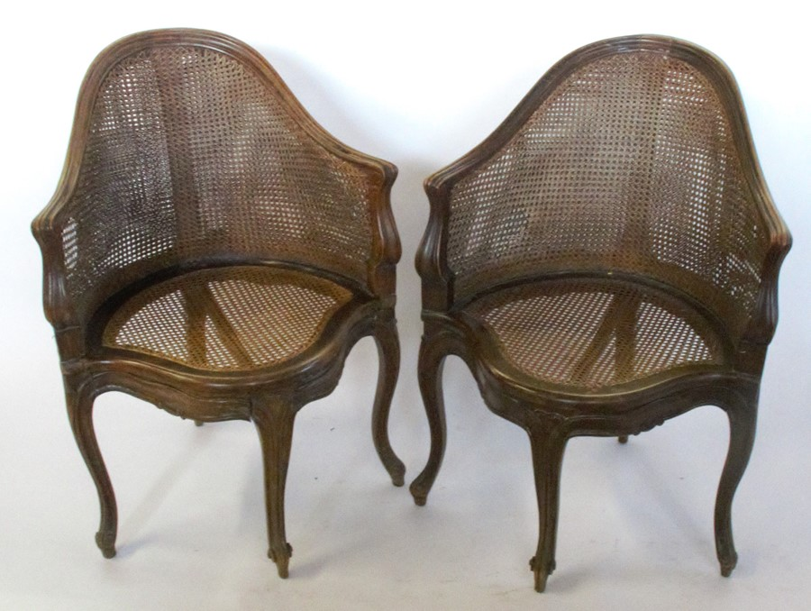 Lot 31 - A set of seven bergere dining chairs, with shaped front rail, raised on craved scroll legs