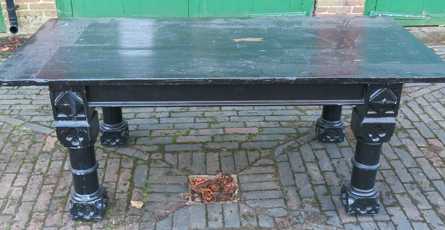 Lot 4 - A painted Gothic style refectory table, raised on four carved and turned legs, with cleated top,