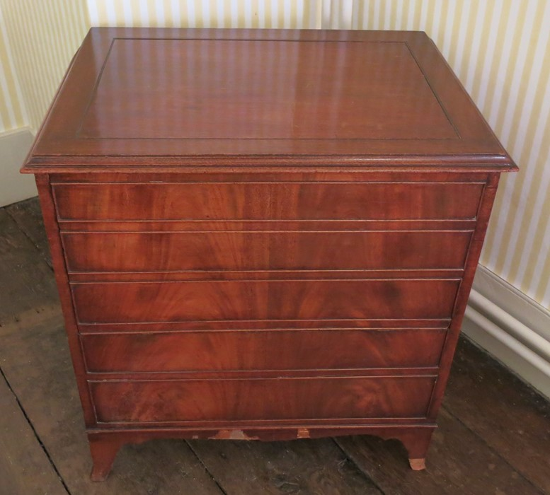 Lot 10 - A Georgian mahogany tray top commode, the gallery top with integral handles, fitted with a