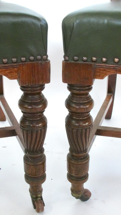 Lot 26 - A set of six oak dining chairs, stamped Thos. Edwards & Sons, with carved and upholstered backs,