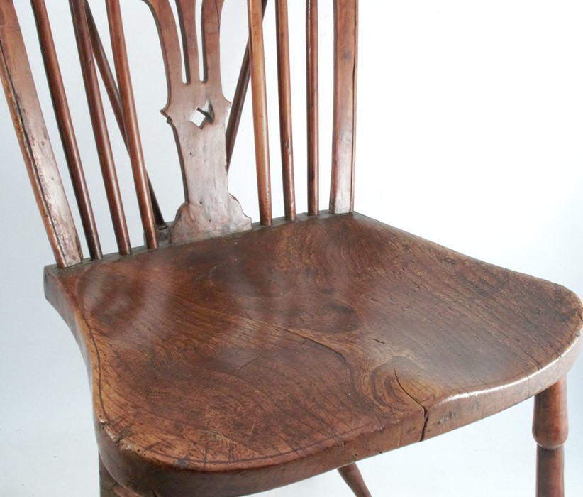 Lot 54 - A 19th century yew wood single chair, with a pierced vase splat back flanked by spindles, and having