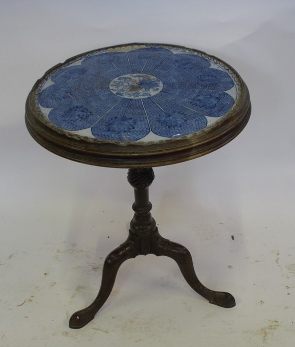 Lot 45 - A late 18th century / early 19th century mahogany circular table, with a turned column raised on a