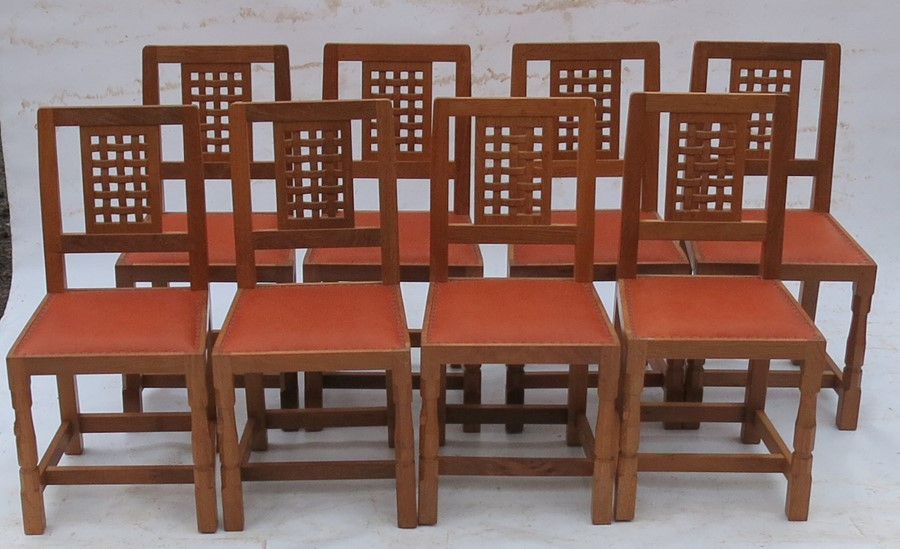 Lot 60 - Robert Thompson Mouseman, a set of 8 single dining chairs, with square lattice design to the back,