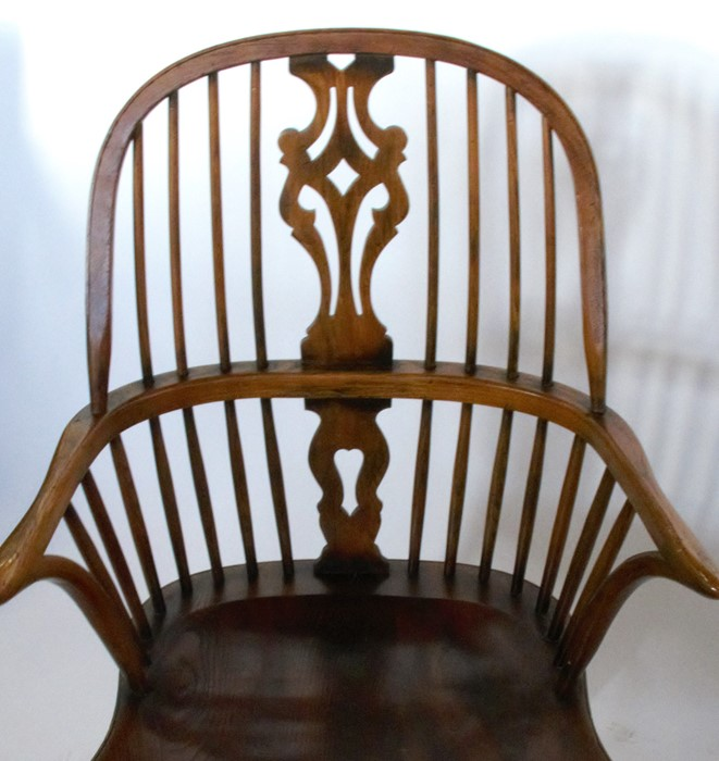 Lot 57 - A pair of Windsor armchairs, with pierced splat back, on turned legs united by a crinoline