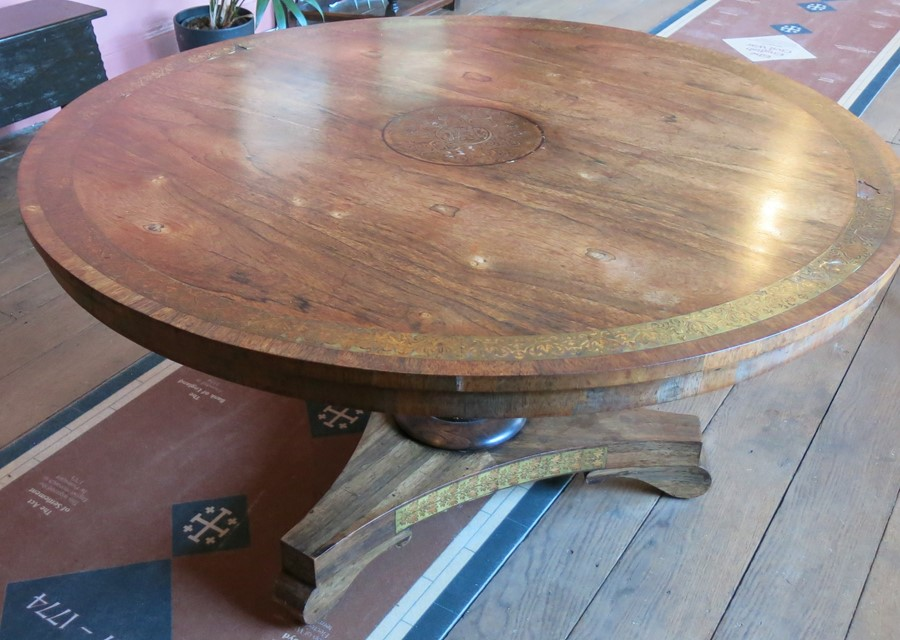 Lot 7 - A Regency rosewood circular breakfast table, with cut brass central panel and border, with further