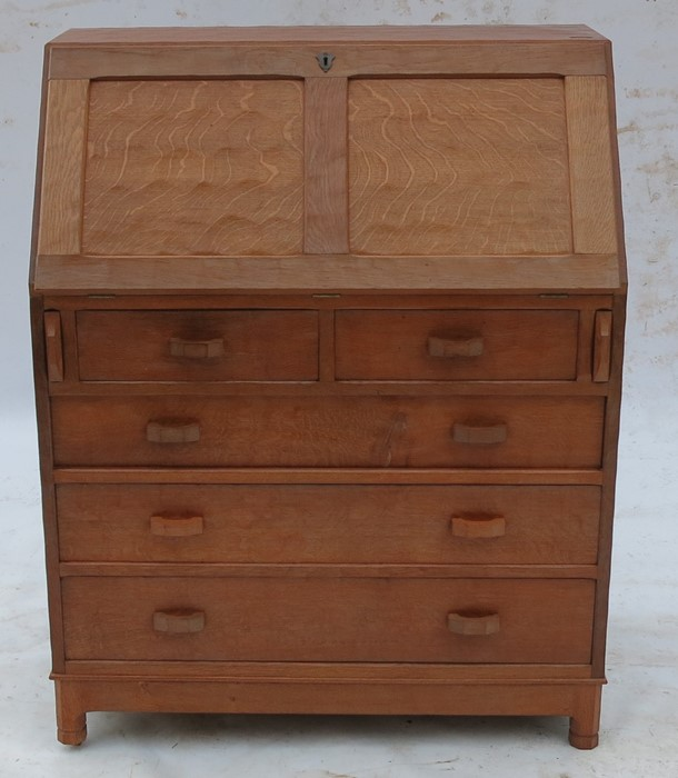 Lot 46 - Alan Grainger Acorn Man, an oak bureau, the fielded fall flap opening to reveal pigeon holes and